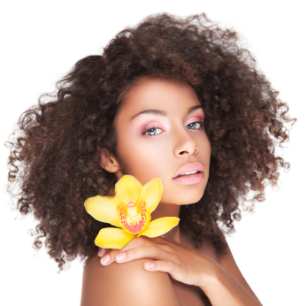 Wavy-haired woman with yellow flower