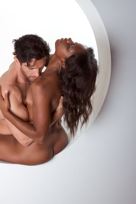 Young Naked Man And Woman Making Love And Kissing Stock Photo